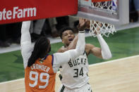 Milwaukee Bucks forward Giannis Antetokounmpo (34) shoots over Phoenix Suns forward Jae Crowder (99) during the second half of Game 4 of basketball's NBA Finals Wednesday, July 14, 2021, in Milwaukee. (AP Photo/Aaron Gash)