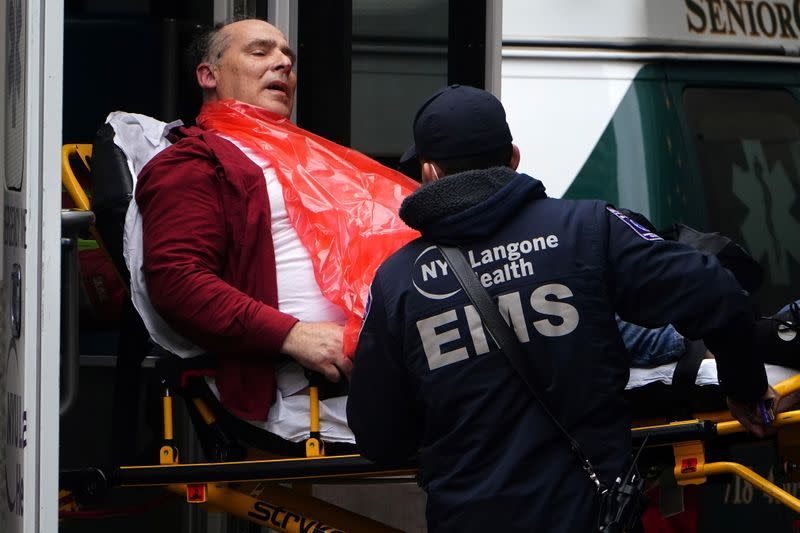 A man is brought to hospital on a stretcher in New York