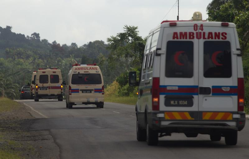 File photo taken in March 2013 shows ambulances driving towards a stand-off between Filipino Sulu gunmen and Malaysian security forces in Tanduo village on Malaysia's Borneo island
