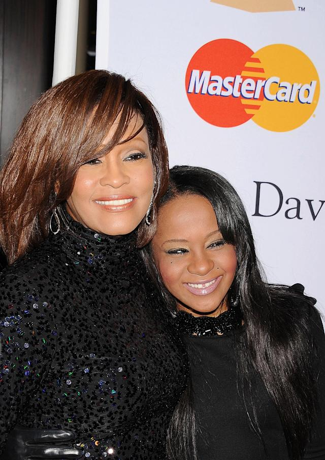 Whitney Houston and daughter Bobbi Kristina arrive at the Clive Davis And The Recording Academy's 2011 Pre-GRAMMY Gala at The Beverly Hilton hotel on February 12, 2011 in Beverly Hills, California. (Photo by Jeffrey Mayer/WireImage)