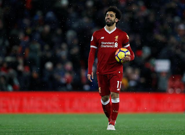 "Soccer Football - Premier League - Liverpool vs Watford - Anfield, Liverpool, Britain - March 17, 2018 Liverpool's Mohamed Salah celebrates with the match ball after the match Action Images via Reuters/Lee Smith EDITORIAL USE ONLY. No use with unauthorized audio, video, data, fixture lists, club/league logos or ""live"" services. Online in-match use limited to 75 images, no video emulation. No use in betting, games or single club/league/player publications. Please contact your account representative for further details."