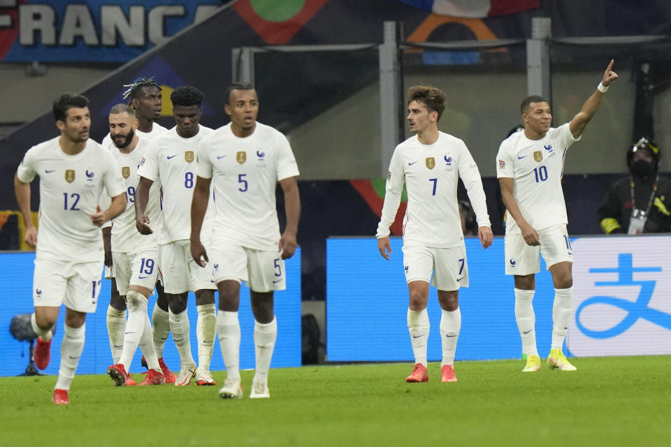 France's Kylian Mbappe, right, celebrates after scoring during the UEFA Nations League final soccer match between France and Spain at the San Siro stadium, in Milan, Italy, Sunday, Oct. 10, 2021. (AP Photo/Luca Bruno)