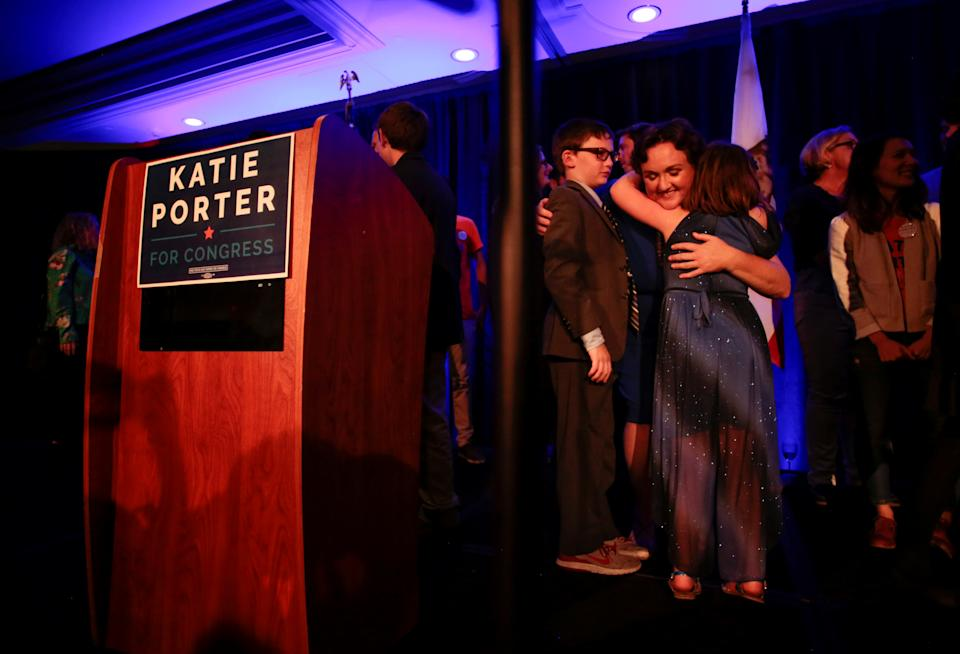 Democratic congressional candidate Katie Porter hugs her children at the end of her midterm election night party in Irvine, California, U.S. November 6, 2018. REUTERS/Kyle Grillot