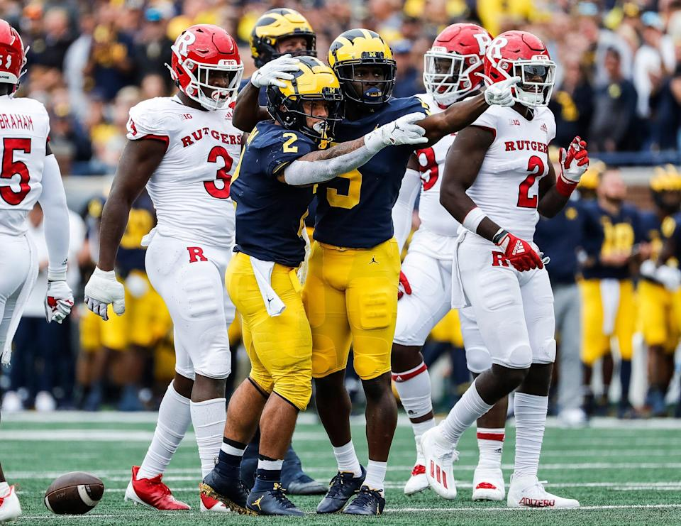 Michigan running back Blake Corum (2) and running back Hassan Haskins (25) celebrate a first down against Rutgers during the first half at Michigan Stadium in Ann Arbor on Saturday, Sept. 25, 2021.