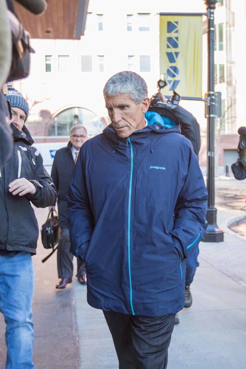 "William ""Rick"" Singer leaves Boston Federal Court after being charged with racketeering conspiracy, money laundering conspiracy, conspiracy to defraud the United States, and obstruction of justice on March 12, 2019 in Boston, Massachusetts."