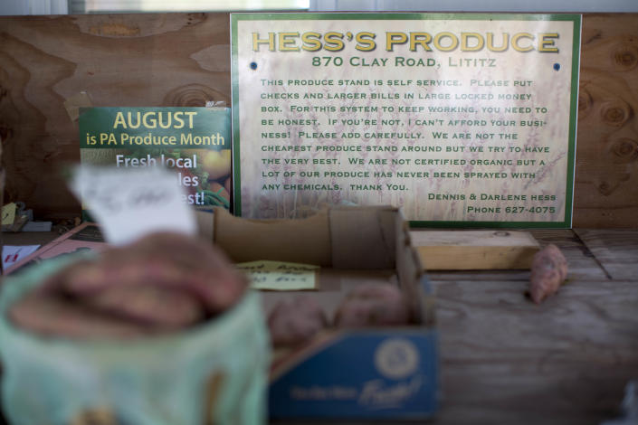 """Shown is the is a sign posted at Dennis and Darlene Hess's farm stand Monday, Nov. 4, 2013, in Litiz, Pa. You can take our word for it: Americans don't trust each other anymore. An AP-GfK poll conducted last month found that Americans are suspicious of each other in everyday encounters. Less than a third expressed a lot of trust in clerks who swipe their credit cards, drivers on the road, or people they meet when traveling. However, there are still trusters around to set an example like Dennis Hess who runs an unattended farm stand on the honor system. Customers pick out their produce, tally their bills and drop the money into a slot, making change from an unlocked cashbox. """"When people from New York or New Jersey come up,"""" said Hess, """"they are amazed that this kind of thing is done anymore."""" (AP Photo/Matt Rourke)"""