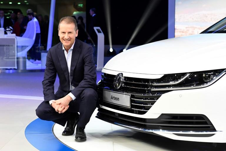 Herbert Diess, chairman of the Volkswagen brand, poses next to the new Arteon during the first press day of the the Geneva International Motor Show on March 7, 2017 in Geneva