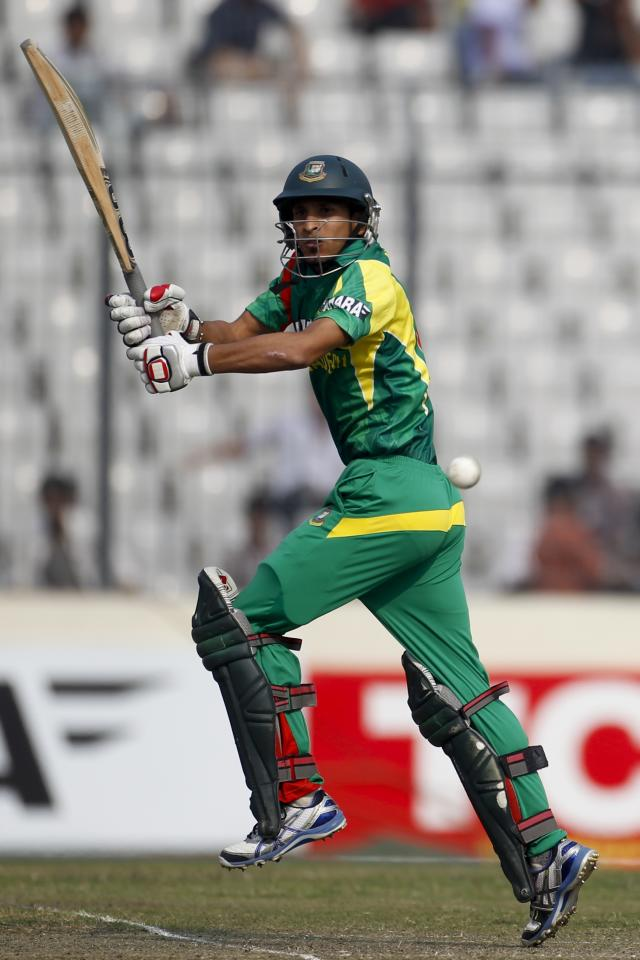Bangladesh's Nasir Hossain plays a ball against Sri Lanka during their third one day international (ODI) cricket match of the series in Dhaka February 22, 2014. REUTERS/Andrew Biraj (BANGLADESH - Tags: SPORT CRICKET)