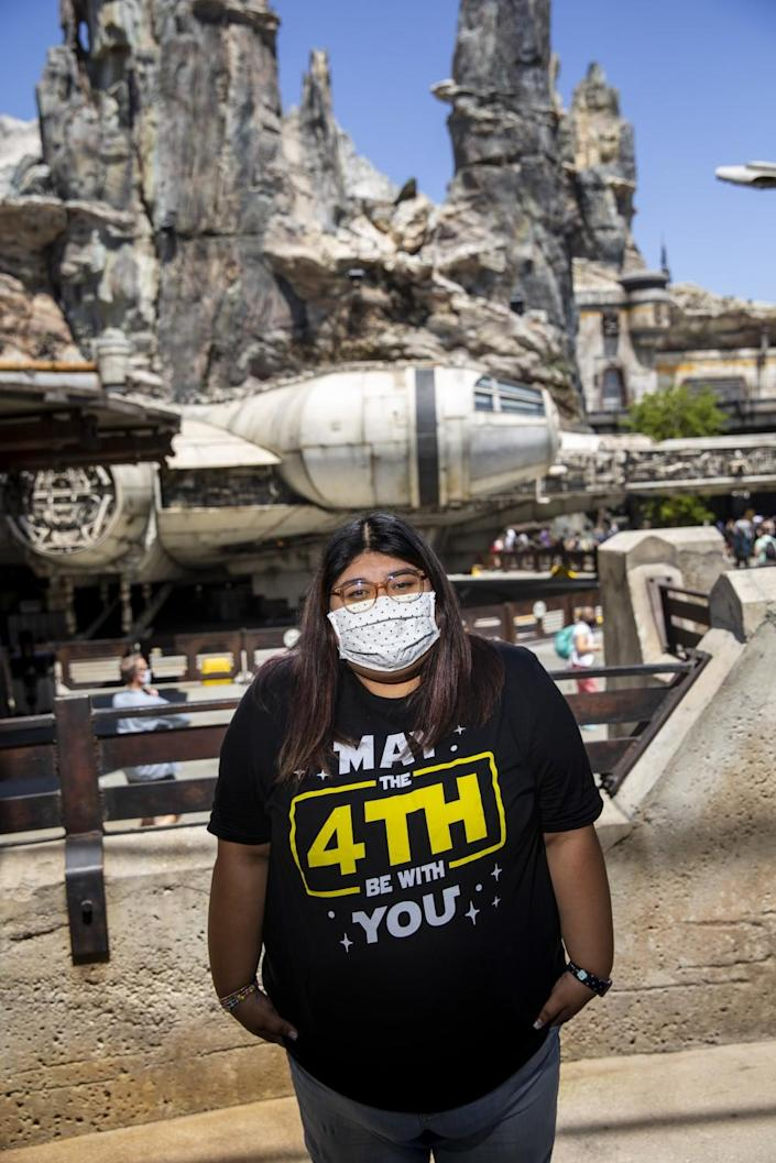 """Evelyn Reyes wears a T-shirt with the message, """"May The 4th Be With You."""""""