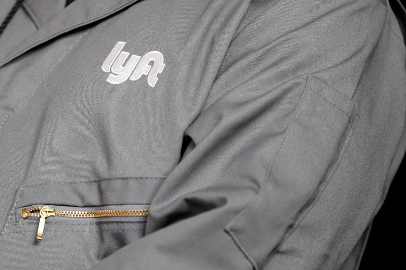 The Lyft logo is shown on an employees uniform as the company is listed on the Nasdaq at an IPO event in Los Angeles, California, U.S. March 29, 2019. REUTERS/Mike Blake
