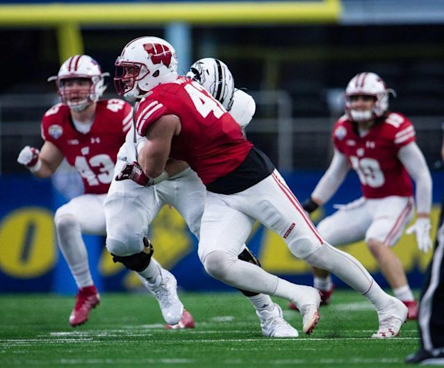 Jan 2, 2017; Arlington, TX, USA; Western Michigan Broncos offensive lineman Taylor Moton (72) and Wisconsin Badgers linebacker T.J. Watt (42) in action in the 2017 Cotton Bowl game at AT&T Stadium. The Badgers defeat the Broncos 24-16. Mandatory Credit: Jerome Miron-USA TODAY Sports