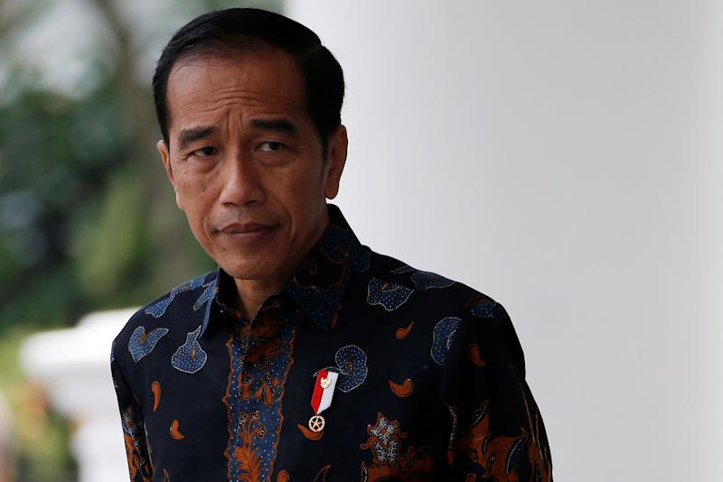 Indonesian President Joko Widodo reacts as he waits for Dutch Prime Minister Mark Rutte before a welcoming ceremony at the presidential palace in Bogor, Indonesia, October 7, 2019. REUTERS/Willy Kurniawan