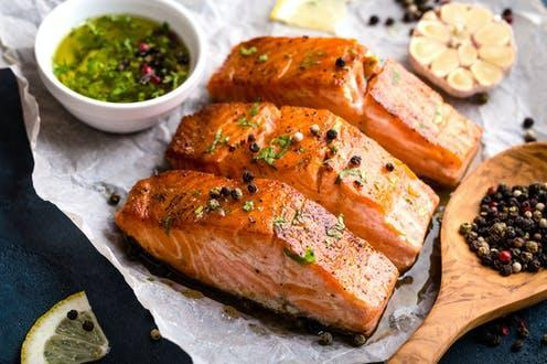 """<span class=""""caption"""">Oily fish, like salmon, are a good source of omega-3 fatty acids.</span> <span class=""""attribution""""><a class=""""link rapid-noclick-resp"""" href=""""https://www.shutterstock.com/image-photo/delicious-fried-salmon-fillet-seasonings-on-719333500"""" rel=""""nofollow noopener"""" target=""""_blank"""" data-ylk=""""slk:Elena Eryomenko/ Shutterstock"""">Elena Eryomenko/ Shutterstock</a></span>"""