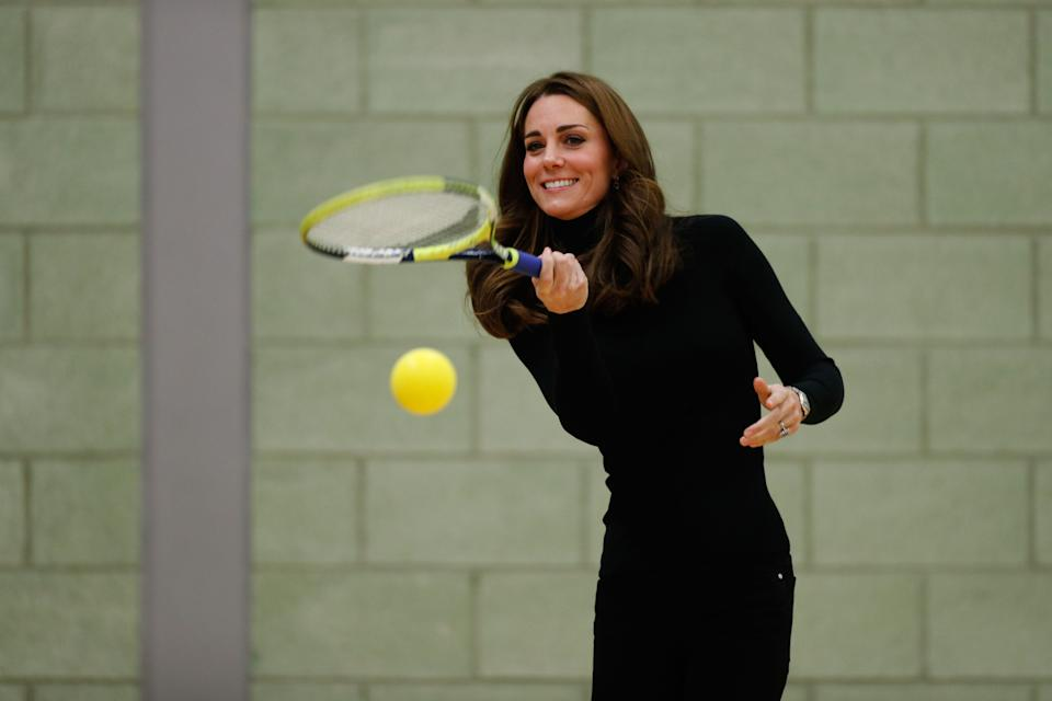 Britain's Catherine, Duchess of Cambridge, plays tennis as she joins a session with a group during a visit the Coach Core Essex apprenticeship scheme at Basildon Sporting Village in Basildon, southeast England, on October 30, 2018. - The Duke and Duchess of Cambridge visited Coach Core Essex to meet new apprentices, hear from graduates, and learn how the scheme in Essex is engaging a diverse local community with sport. The Duke and Duchess met with new Coach Core apprentices and joined in with their coaching sessions, including tennis and indoor athletics. (Photo by Adrian DENNIS / POOL / AFP)        (Photo credit should read ADRIAN DENNIS/AFP via Getty Images)
