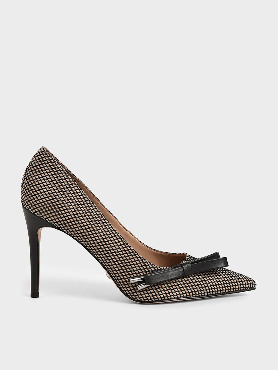"<p><strong>Charles & Keith</strong></p><p>charleskeith.com</p><p><strong>$79.00</strong></p><p><a href=""https://go.redirectingat.com?id=74968X1596630&url=https%3A%2F%2Fwww.charleskeith.com%2Fus%2FSL1-60280353_MULTI.html&sref=https%3A%2F%2Fwww.oprahmag.com%2Fstyle%2Fg34688882%2Fnew-years-eve-outfit-ideas%2F"" rel=""nofollow noopener"" target=""_blank"" data-ylk=""slk:SHOP NOW"" class=""link rapid-noclick-resp"">SHOP NOW</a></p>"