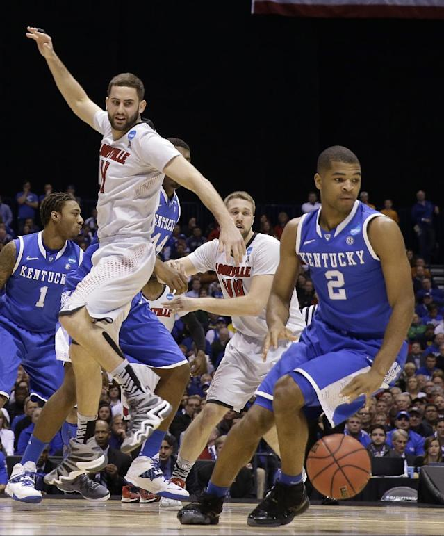 Kentucky's Aaron Harrison (2) steals the ball from Louisville's Luke Hancock (11) during the first half of an NCAA Midwest Regional semifinal college basketball tournament game Friday, March 28, 2014, in Indianapolis. (AP Photo/David J. Phillip)