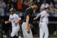Pittsburgh Pirates relief pitcher Kyle Keller, center, reacts as New York Mets' Francisco Lindor, left, runs the bases after hitting a grand slam during the sixth inning of a baseball game Friday, July 9, 2021, in New York. (AP Photo/Frank Franklin II)