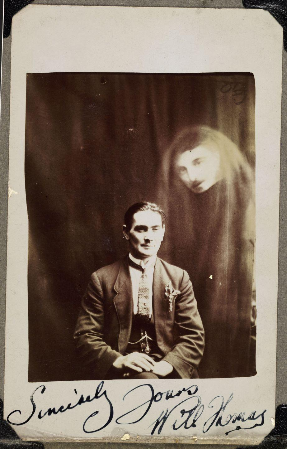 "<p>In the photo, captured by Walsh medium William Hope, a man sits in a chair as the distorted face of an unidentified ""spirit"" floats in the background. </p>"
