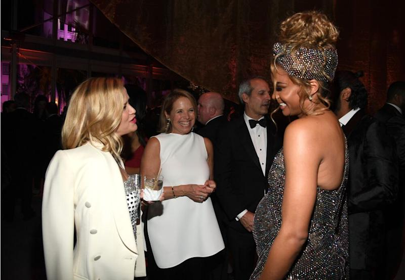 From L to R: Reese Witherspoon, Katie Couric and Ciara at the 2020 Vanity Fair Oscar Party | Kevin Mazur/WireImage