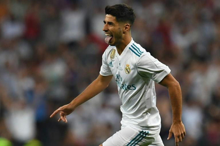 Real Madrid's midfielder Marco Asensio celebrates after scoring the opener during the second leg of the Spanish Supercup football match against Barcelona August 16, 2017