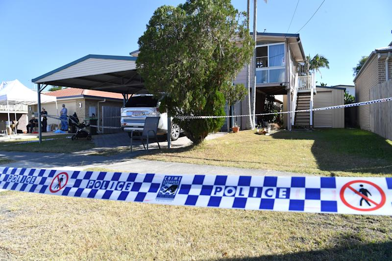 Police are seen at a property in Cannon Hill, Brisbane where the body of the four-year-old girl was found. Source: AAP