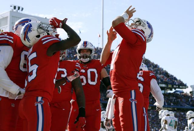 Buffalo Bills quarterback Josh Allen, right, celebrates his touchdown pass to wide receiver John Brown, left, in the second half of an NFL football game Miami Dolphins, Sunday, Oct. 20, 2019, in Orchard Park, N.Y. (AP Photo/Ron Schwane)