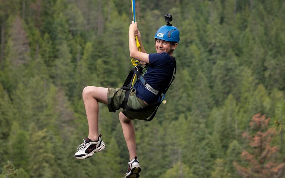 Charlie riding the Kokanee Mountain Zipline