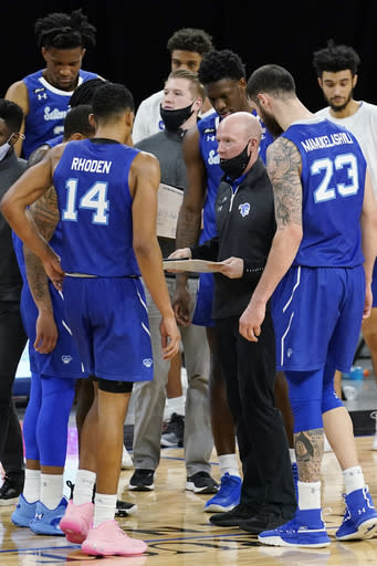 Seton Hall head coach Kevin Willard, second from right, talks to his team during the second half of an NCAA college basketball game against DePaul in Chicago, Saturday, Jan. 9, 2021. (AP Photo/Nam Y. Huh)