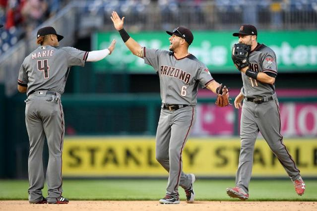 The Arizona Diamondbacks celebrated their ninth straight series win to open the season with Saturday's victory in Washington. (AP)