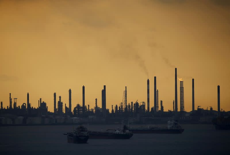 FILE PHOTO: Storm clouds gather over Shell's Pulau Bukom oil refinery in Singapore