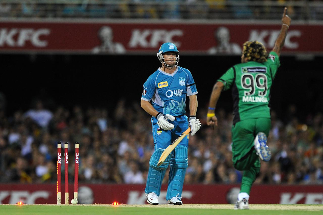 BRISBANE, AUSTRALIA - JANUARY 03:  James Hopes of the Heat is bowled by Lasith Malinga of the Stars during the Big Bash League match between the Brisbane Heat and the Melbourne Stars at The Gabba on January 3, 2013 in Brisbane, Australia.  (Photo by Matt Roberts/Getty Images)