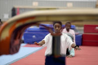 Reigning Olympic champion gymnast Simone Biles stretches during a training session Tuesday, May 11, 2021, in Spring, Texas. (AP Photo/David J. Phillip)