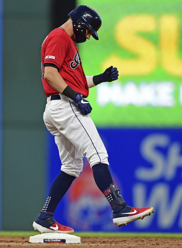 Cleveland Indians' Tyler Naquin celebrates after hitting a two-RBI double in the sixth inning of a baseball game against the Detroit Tigers, Monday, July 15, 2019, in Cleveland. Roberto Perez and Mike Freeman scored on the play. (AP Photo/David Dermer)