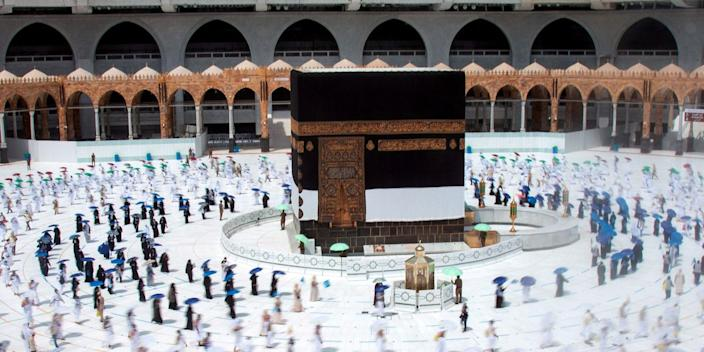 Muslim pilgrims maintain social distancing as they circle the Kaaba at the Grand mosque in Mecca, Saudi Arabia, on July 29, 2020.