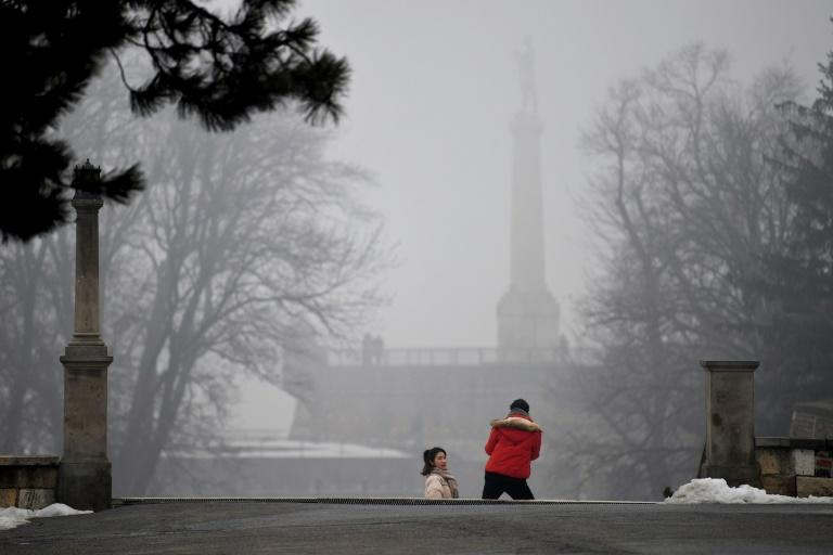 "A tourist poses for a picture near ""The Victor"" (Pobednik) monument in Belgrade (AFP Photo/ANDREJ ISAKOVIC)"