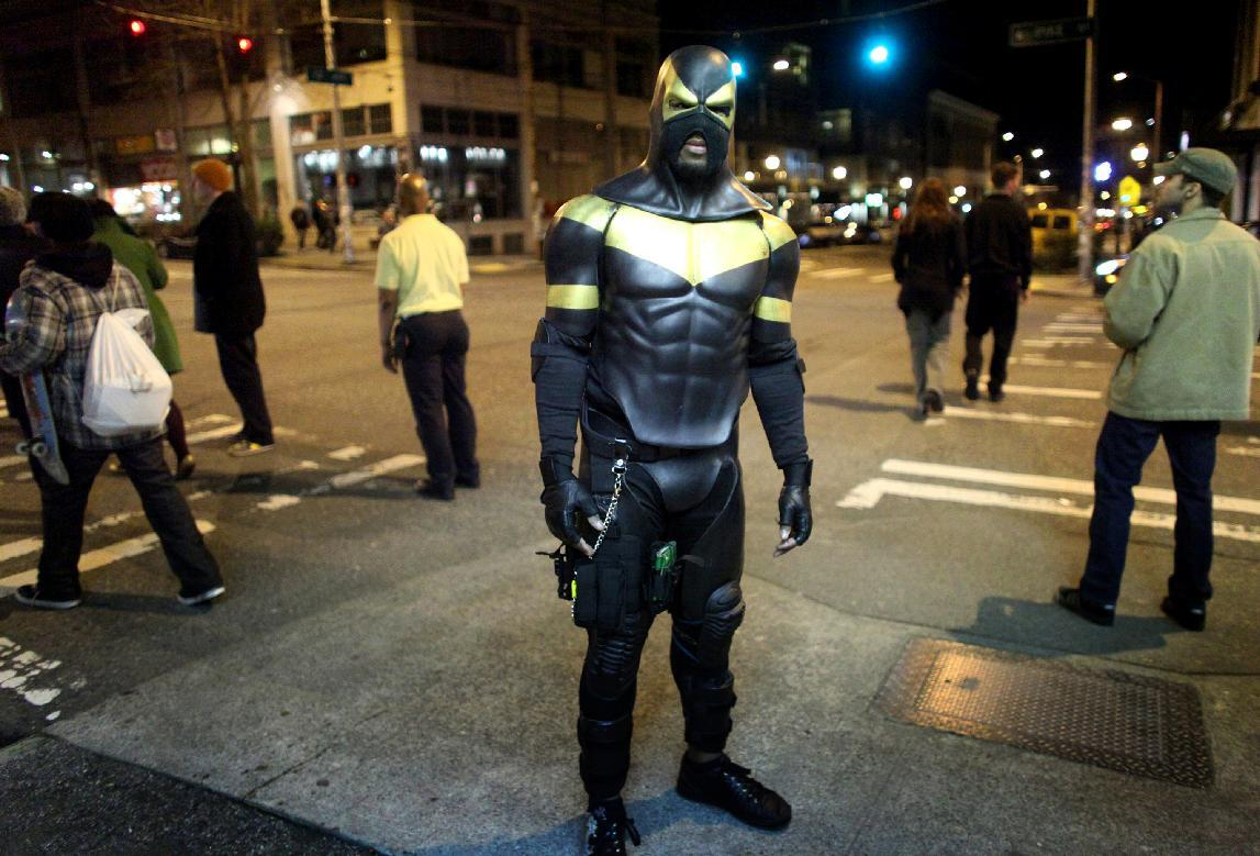 FILE - This Feb. 18, 2011 file photo shows Seattle superhero Phoenix Jones during a patrol of Seattle's Capitol Hill neighborhood. Jones, who has gained fans and a bit of fame as he works the streets of Seattle, was arrested early Sunday after he was accused of assaulting several people with pepper spray. He was booked in county jail on four counts of assault, with arraignment set for Thursday, police said Monday. Jones says he was only trying to stop a street brawl. (AP Photo/seattlepi.com, Joshua Trujillo, File)