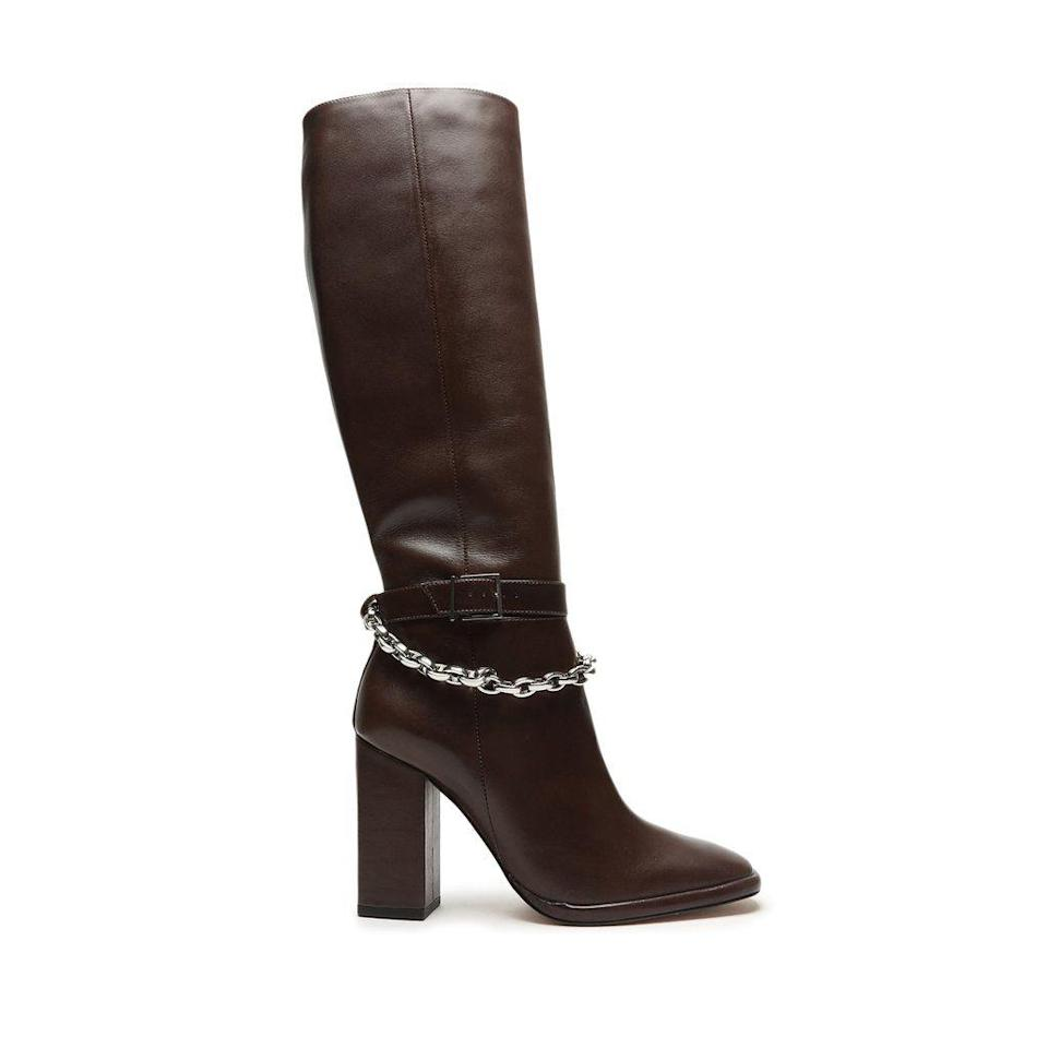"""<p><strong>Schutz</strong></p><p>schutz.com</p><p><strong>$298.00</strong></p><p><a href=""""https://go.redirectingat.com?id=74968X1596630&url=https%3A%2F%2Fschutz-shoes.com%2Fproducts%2Florina-f20-high-heel-leather-boot%3Fcolor%3Dumber&sref=https%3A%2F%2Fwww.cosmopolitan.com%2Fstyle-beauty%2Ffashion%2Fg35017315%2F2021-shoe-trends%2F"""" rel=""""nofollow noopener"""" target=""""_blank"""" data-ylk=""""slk:Shop Now"""" class=""""link rapid-noclick-resp"""">Shop Now</a></p><p>Square-toe boots will look so good this winter. Wear these guys with a pair of jeans or with a midi-length dress.</p>"""