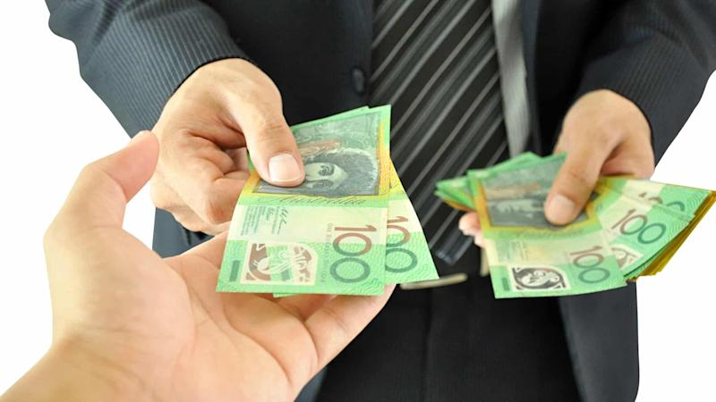 Businessman paying Australian money