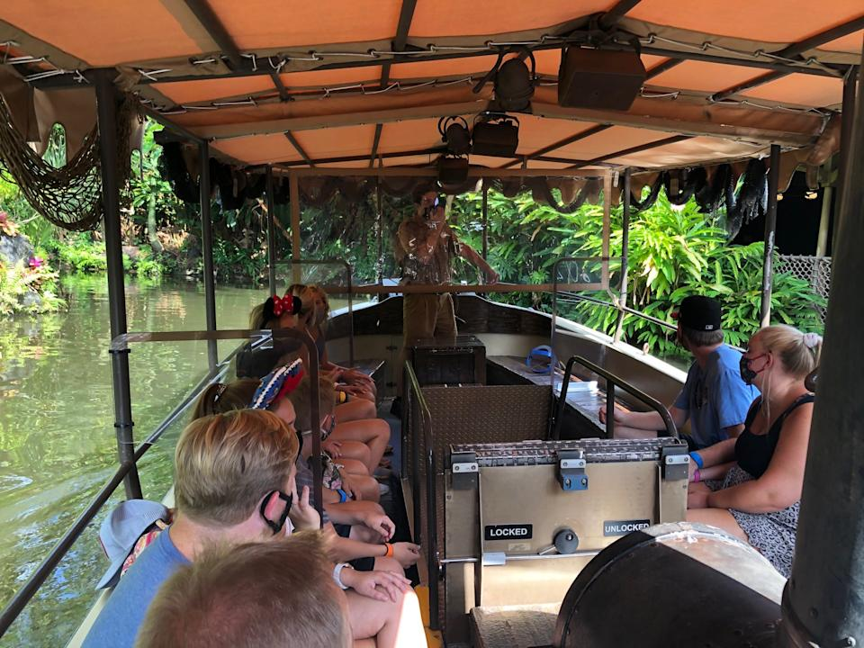 """Jungle Cruise guides now deliver their pun-filled spiels about """"the backside of water"""" from behind face masks and transparent vinyl curtains."""