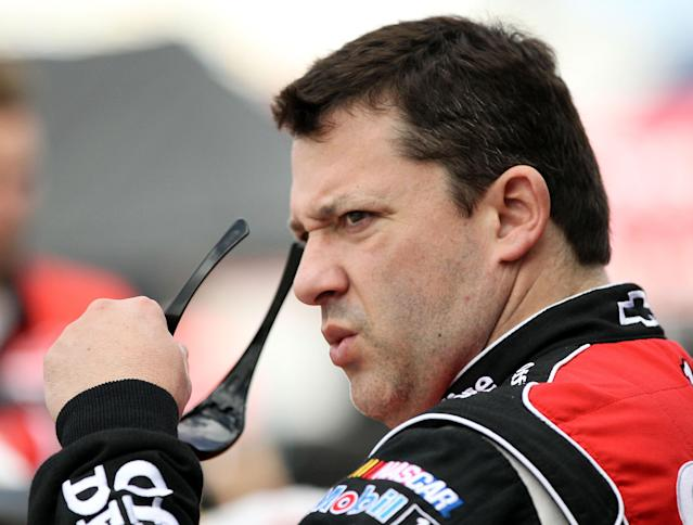 DAYTONA BEACH, FL - FEBRUARY 18: Tony Stewart, driver of the #14 Office Depot/Mobil 1 Chevrolet, looks on during practice for the NASCAR Sprint Cup Series Daytona 500 at Daytona International Speedway on February 18, 2012 in Daytona Beach, Florida. (Photo by Jamie Squire/Getty Images)