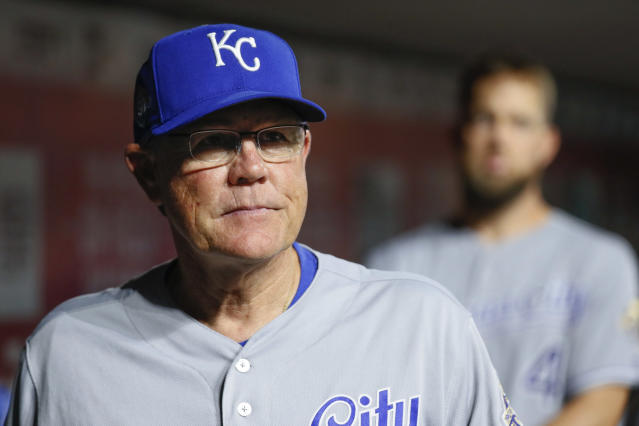 FILE - In this Sept. 25, 2018, file photo, Kansas City Royals manager Ned Yost stands in the dugout during the fourth inning of the team's baseball game against the Cincinnati Reds, in Cincinnati. I was so enthused with the progress we made in the last half of the season last year, how well these kids played, Yost said. All the hard work they put in every single day when nobody was looking, it finally started to pay off for them the last six weeks. I just think we continue to pick up where we left off. Where we left off is OK. (AP Photo/John Minchillo, File)