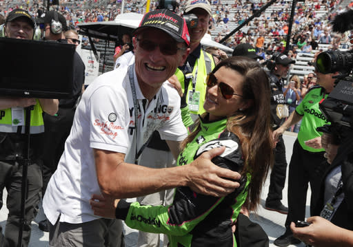 Danica Patrick is hugged by Patrick Bourdais after she qualified for the IndyCar Indianapolis 500 auto race at Indianapolis Motor Speedway in Indianapolis, Saturday, May 19, 2018. (AP Photo/Michael Conroy)