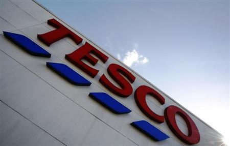 A store sign is seen outside a Tesco supermarket in London