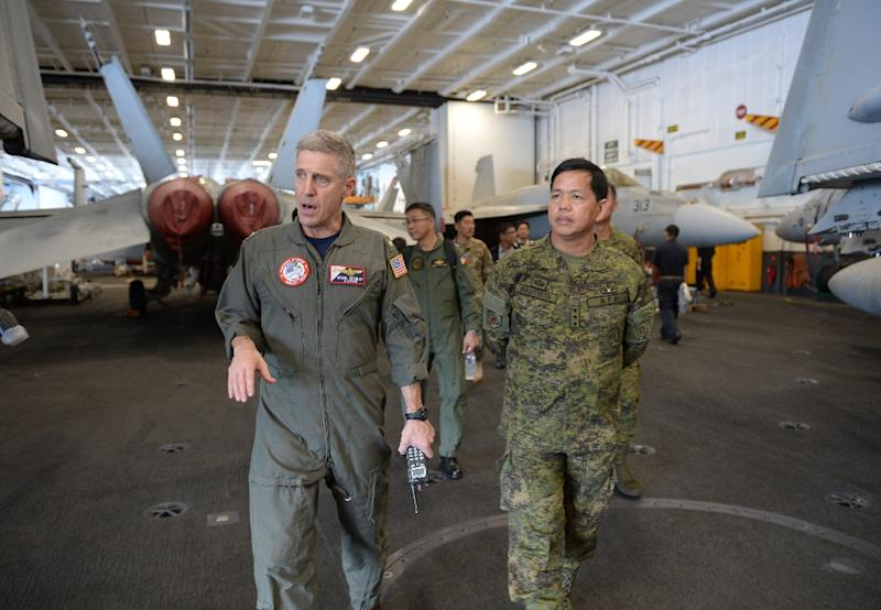 Rear Admiral Steve Khoeler (L, with visiting Philippine army chief Lieutenant General Rolando Bautista) acknowledges 'there's a lot of disputes' over the South China Sea (AFP Photo/TED ALJIBE)