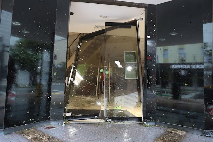 A door is seen blown in at a Regions Bank in Miami, Florida.