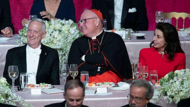PHOTO: Former U.S. Secretary of Defense Jim Mattis, left, Cardinal Timothy Dolan, center, and Happy Warrior Award Recipient Mary Ann Tighe react to opening remarks during the 74th Annual Alfred E. Smith Dinner, Thursday, Oct. 17, 2019, in New York. (Mary Altaffer/AP)