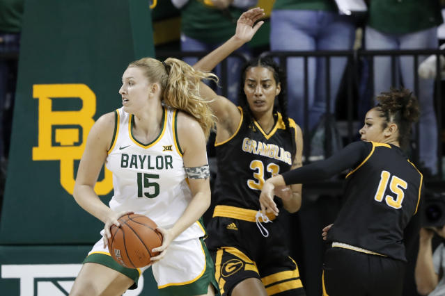 Baylor forward Lauren Cox (15) works to the basket for a shot-attempt as Grambling State's Kailyn Gideon (33) and Candice Parramore (15) in the first half of an NCAA college basketball game in Waco, Texas, Friday, Nov. 8, 2019. (AP Photo/Tony Gutierrez)