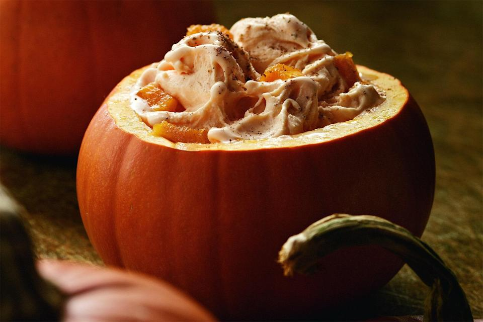 """Add canned pumpkin, cinnamon, and a dash of rum to a classic custard base for this creamy dream of a frozen treat. <a href=""""https://www.epicurious.com/recipes/food/views/alexander-mccream-spiced-pumpkin-ice-cream-51187420?mbid=synd_yahoo_rss"""" rel=""""nofollow noopener"""" target=""""_blank"""" data-ylk=""""slk:See recipe."""" class=""""link rapid-noclick-resp"""">See recipe.</a>"""