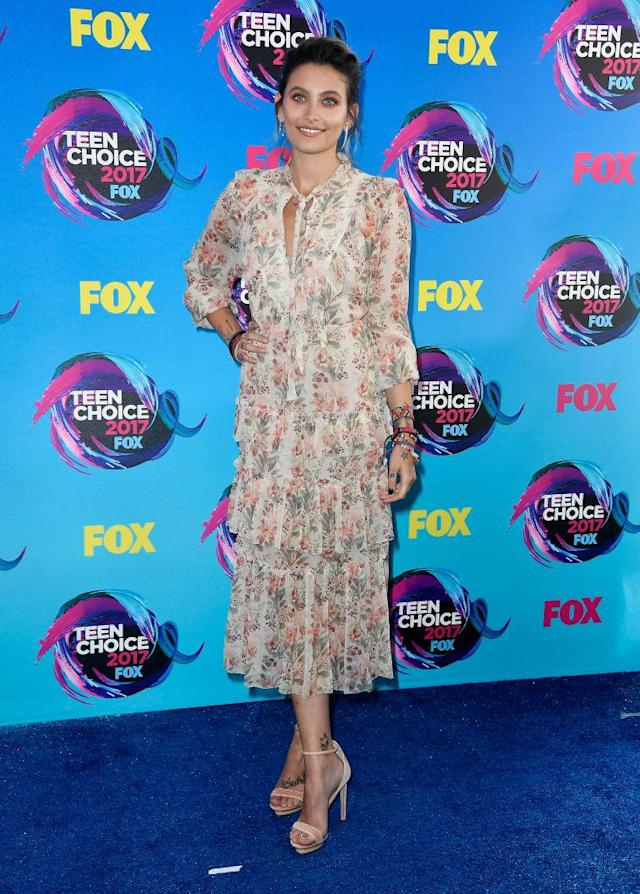 <p>The singer's daughter and social media star showed off her boho vibes in a floral dress and a loose up-do. (Photo: Getty Images) </p>