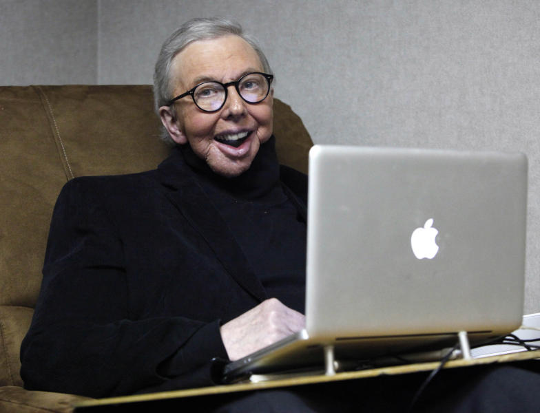 """FILE - In this Jan. 12, 2011 file photo, film critic Roger Ebert works in his office at the WTTW-TV studios in Chicago. When """"Life Itself"""" debuts Sunday, Jan. 19, 2014, at the Sundance Film Festival it will be the first time Ebert's wife, Chaz, will see the full documentary about her late husband's life. """"Life Itself"""" includes footage that director Steve James gathered over the final four months before the famed film critic died last April after a long battle with cancer. (AP Photo/Charles Rex Arbogast, File)"""